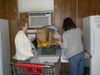 Volunteers weighing food for client request